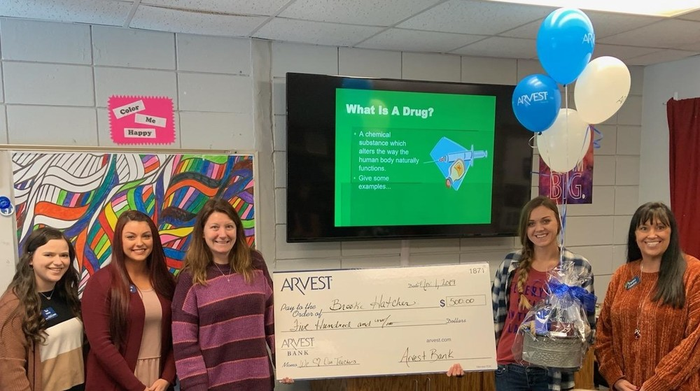 Arvest Surprises PMS Teacher with $500